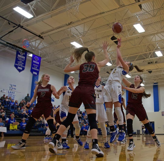 Zoe Bratcher, right, puts up a shot for Veribest during a game against Rankin on Friday, Feb. 21, 2020.