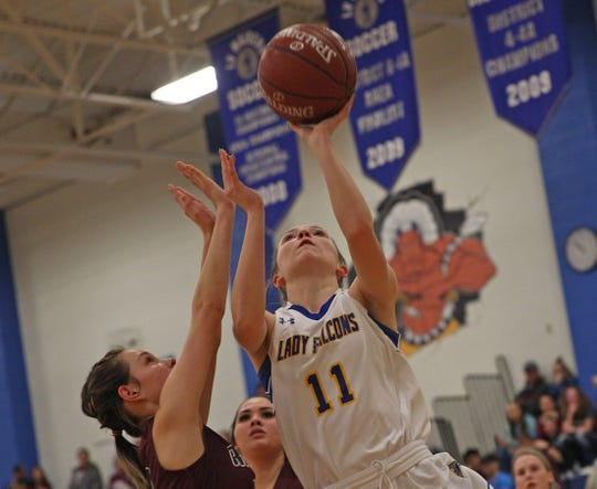 Cora Blackwell, center, puts up a shot for Veribest during a game against Rankin on Friday, Feb. 21, 2020.