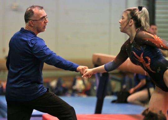 San Angelo Central High School girls gymnastics coach Tony Walker congratulates Jadyn Sawyer after her balance beam routine in a home meet against Saginaw on Saturday, Feb. 22, 2020.