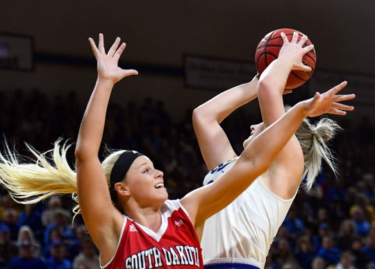 USD's Madison McKeever attempts to block a shot by SDSU's Paiton Burckhard during their game on Saturday, Feb 22, at Frost Arena in Brookings.