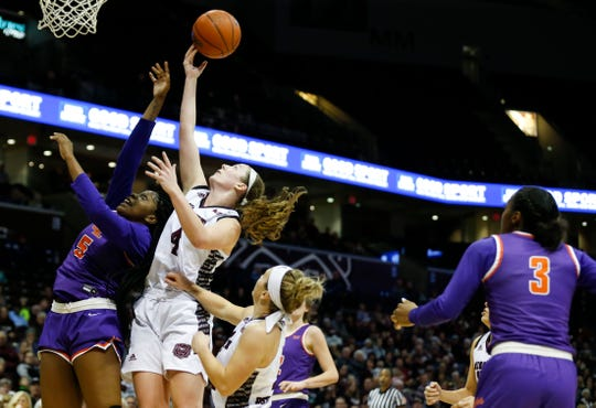 Missouri State Lady Bears forward Abby Hipp (4) and Evansville Purple Aces forward Jada Poland (5) fight for a rebound under the Bears basket during a game at JQH Arena on Friday, Feb. 21, 2020.