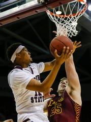Isiaih Mosley, of Missouri State, puts up a shot during the Bears game against Loyola at JQH Arena on Saturday, Feb. 22, 2020.