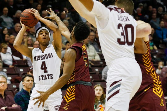 Ja'Monta Black, of Missouri State, looks to pass the ball during the Bears game against Loyola at JQH Arena on Saturday, Feb. 22, 2020.