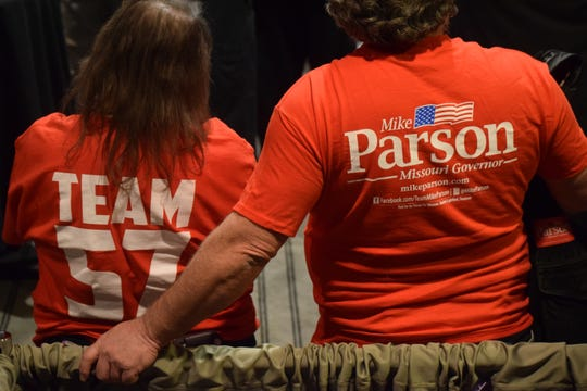 Attendees at a rally for Gov. Mike Parson sport campaign gear on Friday, Feb. 21, 2020 at University Plaza Hotel.