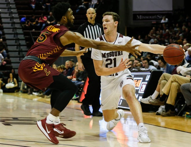 Ross Owens, of Missouri State, passes the ball during the Bears' 74-62 win over Loyola at JQH Arena on Saturday, Feb. 22, 2020.