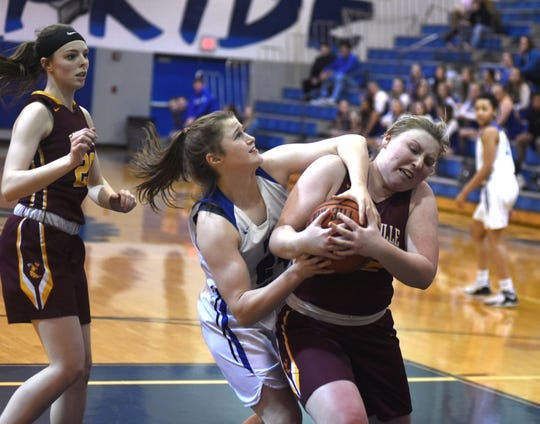 Fort Defiance's Lilian Berry battles for a rebound Friday night in a Region 3C quarterfinal win over Brookville.