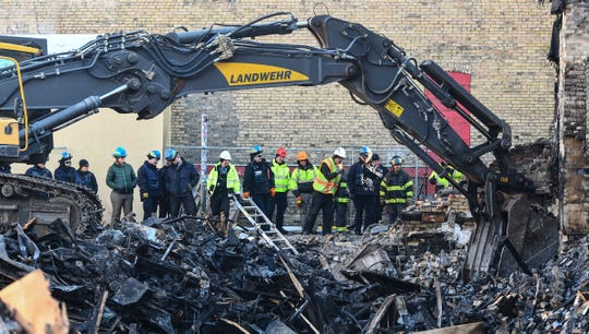 Investigators from the National Response Team of the Bureau of Alcohol, Tobacco, Firearms and Explosives look through debris at the former site of the Press Bar Saturday, Feb. 22, 2020, in downtown St. Cloud.