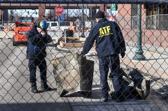 Investigators from the National Response Team of the Bureau of Alcohol, Tobacco, Firearms and Explosives photograph items removesd from the former site of the Press Bar Saturday, Feb. 22, 2020, in downtown St. Cloud.