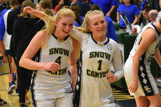 Hallie Remund (left) and Tylei Jensen (right) celebrate their playoff win over Dixie.
