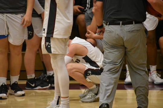Pine View's Ryan Hopper crouches in disbelief after the Panthers' last play failed to get a shot off, and Desert Hills won 57-56.