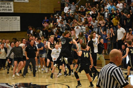 Desert Hills celebrates stunning Pine View on the Panthers home court Friday night.