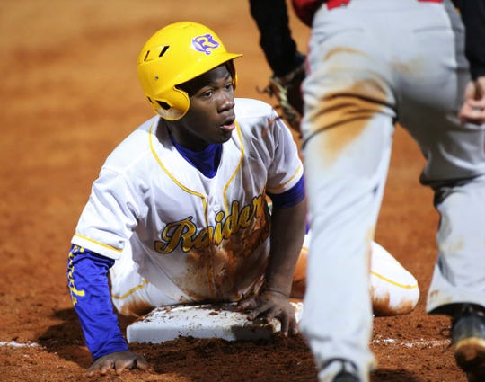Rickards junior Eddie Hills slides into third base safely as Rickards' baseball team walked off to beat Hamilton County 9-8 in the Raiders' first on-campus baseball game, Feb. 21, 2020.