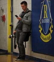 Democrat prep sports editor Brian Miller hangs out, camera and phone in hand, at a  Rickards basketball game.
