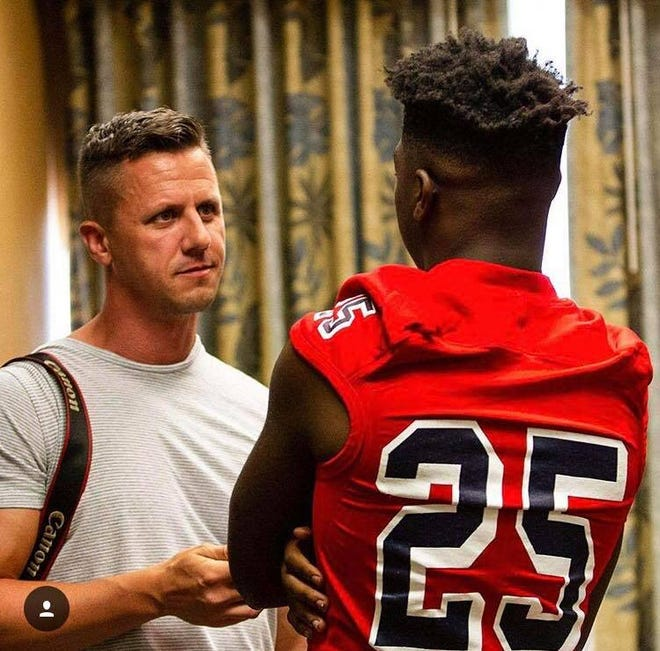Democrat prep sports editor Brian Miller talks to a Wakulla football player during the 2018 high school football media day.