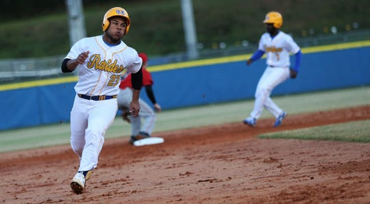 Rickards junior Will Brown races around the bases as Rickards' baseball team walked off to beat Hamilton County 9-8 in the Raiders' first on-campus baseball game, Feb. 21, 2020.