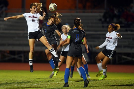 Vero Beach High School's Madelaine Rhodes (10) tries to head the ball into the goal on Friday, Feb. 21, 2020, during the Class 7A state semifinal match against Cypress Bay. Vero Beach lost 1-0 to end their season.