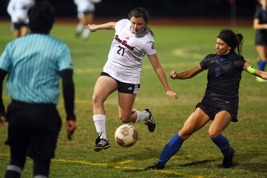 Vero Beach High School's Madison Coddington tries to move the ball up the field past the defense of Cypress Bay's Alexandra Goffi on Friday, Feb. 21, 2020, during the Class 7A state semifinal match at Cypress Bay High School. Vero Beach ended their season with a 1-0 loss.