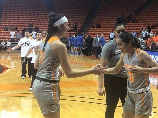 Tatiana Modawar (right) greets Katia Gallegos in pre-game introductions Saturday at the Don Haskins Center