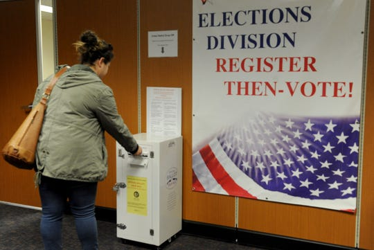 Grace Kelly, of Santa Paula, casts her ballot Feb. 22 at the Ventura County Elections Division in Ventura.
