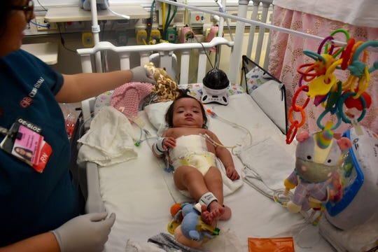 Janessa Torres, of Oxnard, has spent the first six months of her life at the neonatal intensive care unit in the Cedars-Sinai Medical Center.