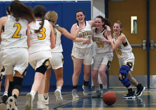 Walter Panas players celebrate their 50-48 victory over Clarkstown South in girls basketball action at Walter Panas High School in Cortlandt Feb 21, 2020.