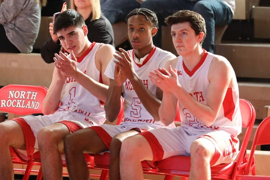 North Rockland's Matt Konicoff, Sidney Zamor and Theo Bosecker watch from the bench during the final minutes of their game, during the North Rockland vs. Fox Lane Section 1 Class AA first round boys basketball game at North Rockland High School, Feb. 22, 2020. North Rockland beat Fox Lane, 67-50.