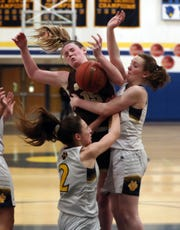 Walter Panas' Kristen Cinquina (2) and Kelsey Cregan (30) battle for a rebound with Clarkstown South's Kelly O'Sullivan (15) during girls basketball action at Walter Panas High School in Cortlandt Feb 21, 2020. Panas won the game 50-48.