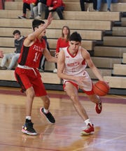 North Rockland's Matt Konicoff drives the ball around Fox Lane's Justin Allen during the North Rockland vs. Fox Lane Section 1 Class AA first round boys basketball game at North Rockland High School, Feb. 22, 2020.