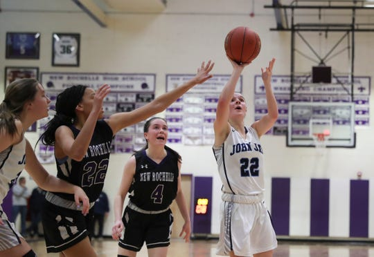 John Jay-East Fishkill's Alyssa Caswell  (22) puts up a shot during their 54-43 win over New Rochelle in the opening round of the Class AA girls basketball tournament at New Rochelle High school in New Rochelle on Saturday, February 22, 2020.