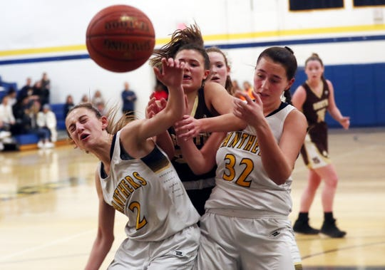 Walter Panas' Kristen Cinquina (2) and Erijona Rraci (32) battle for a rebound with Clarkstown South's Jenny Palmer (22) during girls basketball action at Walter Panas High School in Cortlandt Feb 21, 2020. Panas won the game 50-48.