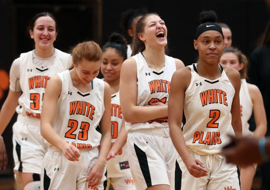 White Plains players celebrate after defeating North Rockland 52-41 in girls basketball playoff action at White Plains High School Feb 22, 2020.