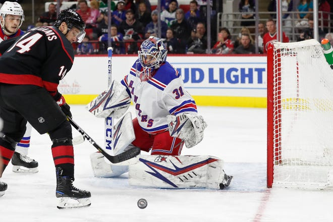 New York Rangers goaltender Igor Shesterkin (31), of Russia, defends the goal against Carolina Hurricanes right wing Justin Williams (14) during the second period of an NHL hockey game in Raleigh, N.C., Friday, Feb. 21, 2020.