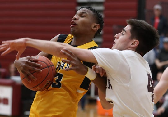 Panas' Caleb Evans, left, fights for the ball with Harrison's Reece Mullahy during their Class A first round playoff game at Harrison Feb. 21, 2020. Harrison won 70-67 in double OT.