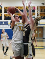 Walter Panas'  Erijona Rraci (32) goes up for a shot in front of Clarkstown South's Kelly O'Sullivan (15) during girls basketball action at Walter Panas High School in Cortlandt Feb 21, 2020. Panas won the game 50-48.
