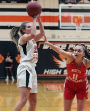 White Plains'  Julia Reggio (22) puts up a shot in front of North Rockland's Grace Mallozzi (11)  during girls basketball playoff action at White Plains High School Feb 22, 2020. White Plains won the game 52-41.
