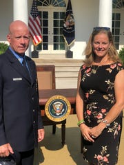 Daniel and Carrie Foley at the White House on July 29, 2019, the day President Trump signed legislation extending aid for people who have fallen ill from 9/11 exposure.