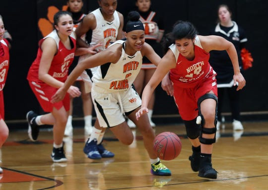 From left, White Plains' Aliya McIver (2) and North Rockland's Alana Melendez (24) go after a loose ball during girls basketball playoff action at White Plains High School Feb 22, 2020. White Plains won the game 52-41.