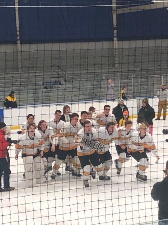 Tatnall players celebrate their championship.
