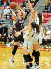 Bowie's Abbi Gamblin goes up for a shot over Cisco's Avery Lewis and Kenzie Gayle in a Region I-3A area playoff game at Mineral Wells on Friday, Feb. 21, 2020.
