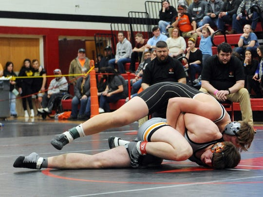 Tri-Valley's A.J. Collins rides New Lex's Titan Blair in the 220 final at the Muskingum Valley League Wrestling Tournament on Saturday at Crooksville High School.