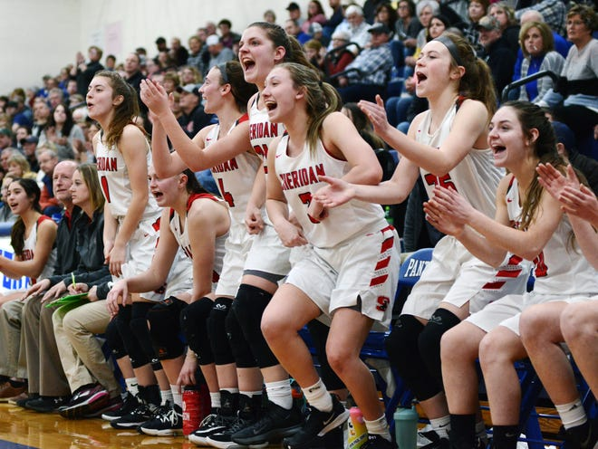 Sheridan players celebrate Abby Dupler's basket to close the fourth quarter of a 41-25 win against Washington Court House Miami Trace in a Division II district semifinal at Chillicothe Southeastern.