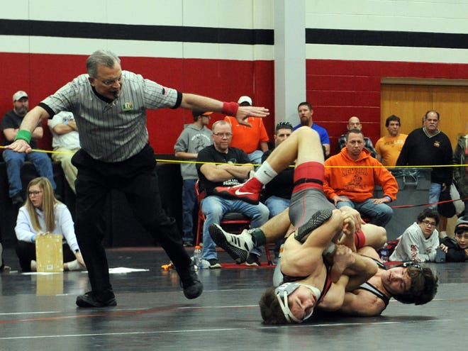 New Lex's Shaun Pletcher has Sheridan's Deven Factor in a hold in the 138-pound final at the Muskingum Valley League Wrestling Tournament on Saturday at Crooksville High School.