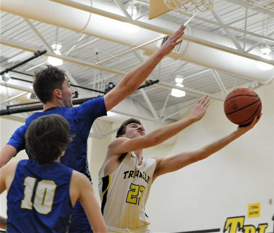 Tri-Valley's Jack Lyall puts up a layup against Philo's A.J. Clayton in Friday's 64-57 win. The Scotties clinched a share of the MVL title with the victory.