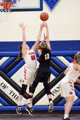 Faith Stinson, left, blocks a shot during Sheridan's 41-25 win against Miami Trace in a Division II district semifinal on Friday night at Chillicothe Southeastern.