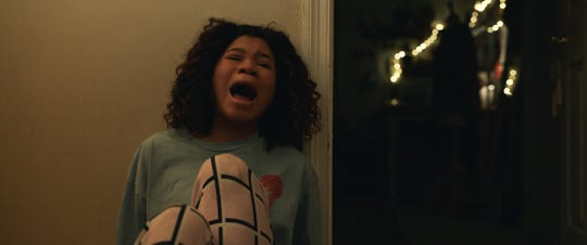 "Teenage Sydney (Storm Reid) gets terrorized, too, in ""The Invisible Man."""