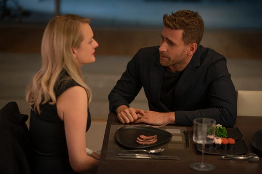 "Cecilia (Elisabeth Moss, left) tries to escape the control of optics pioneer Adrian Griffin (Oliver Jackson-Cohen) in ""The Invisible Man."""