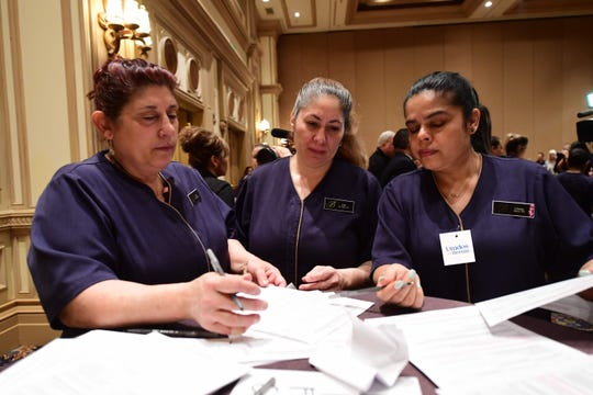 Bellagio hotel workers check in before caucusing at the Bellagio Hotel in Las Vegas, Nevada, on Saturday.