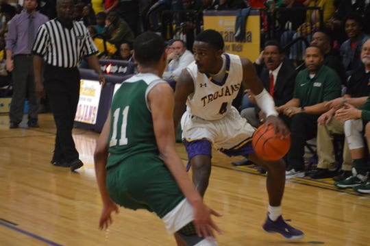 ASH's Latrell Holly (4) looks for the open man during Saturday's Hall of Fame Game against Peabody.
