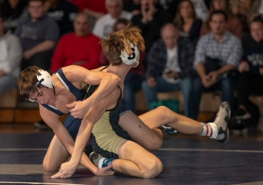 Howell's Colin Bradshaw (left), shown wrestling Southern's Pat Iacoves on Feb. 14, was the District 25 113-pound champion and won of four Howell champions in that tournament Saturday