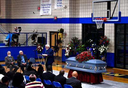 "Bob Martin, pastor at Elm Street Church of Christ in Coleman, leads the service for Howard ""Coach"" Childress on Friday in the Coleman High School gymnasium."